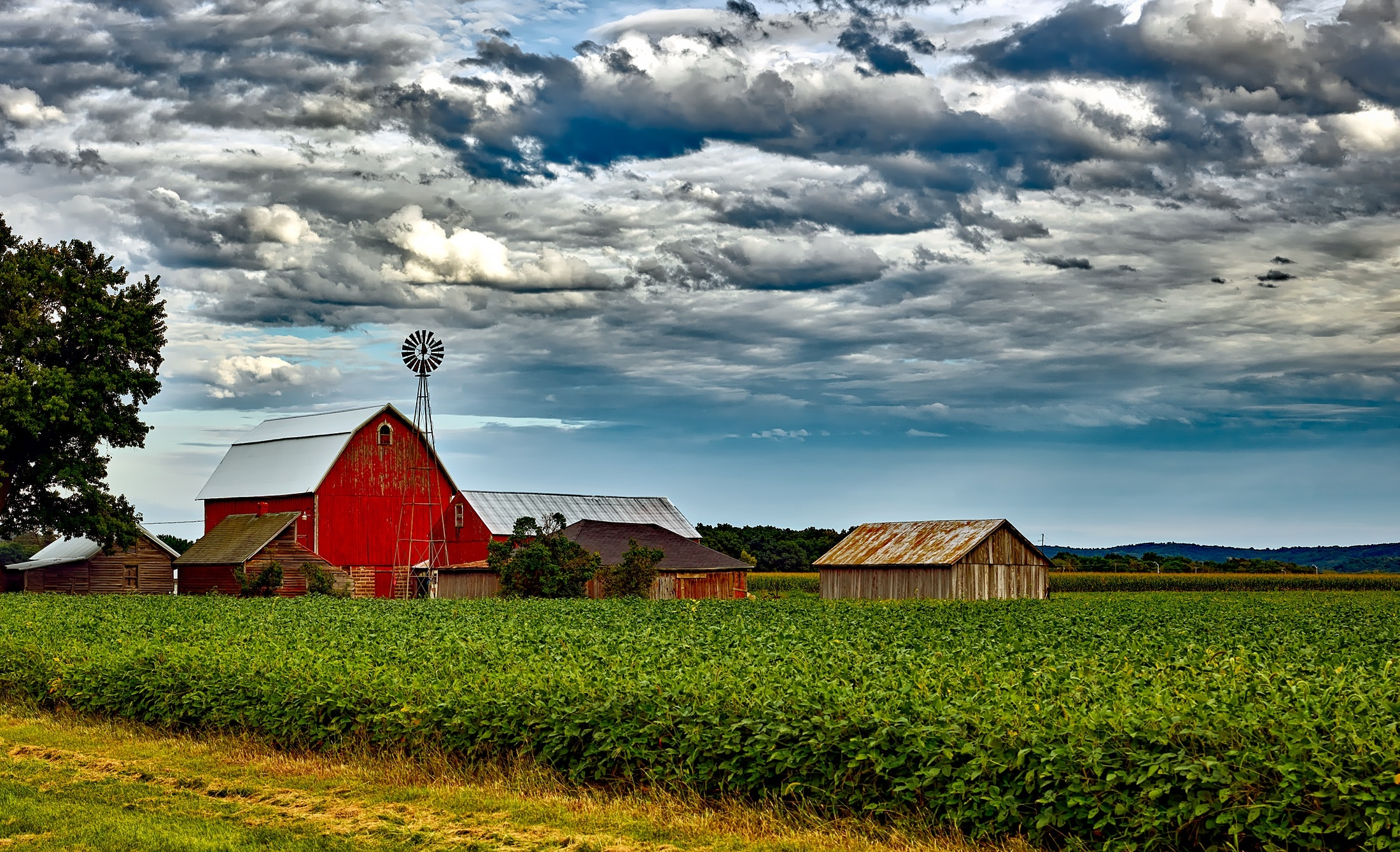 barn-buildings-clouds-248880